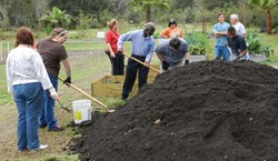 Photo of NSBHS Students helping fill the raised beds with CSI Natural Spent Compost.